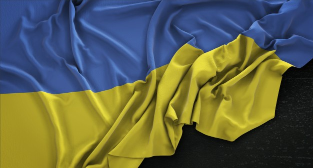 ukraine-flag-wrinkled-on-dark-background-3d-render_1379-785